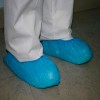 Green plastic shoe covers 100 units